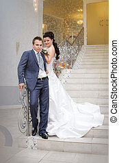 bride and groom on front staircase