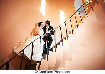 Happy bride and groom on ladder