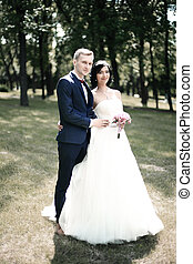 happy bride and groom on the background of a Park