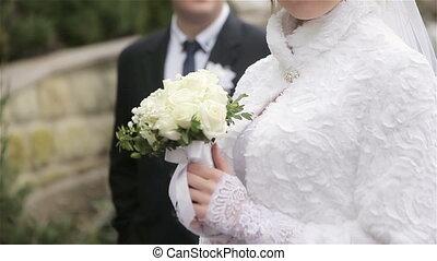 Happy bride and groom posing
