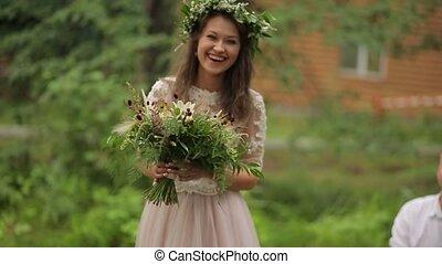 Happy bride goes to groom