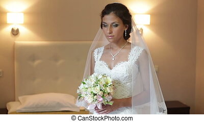 happy bride holding a bouquet