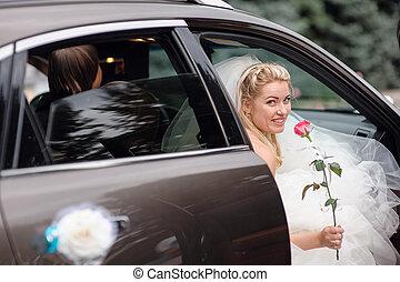 happy bride in a wedding car