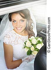 happy bride in the car