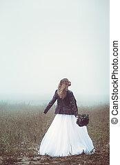 Happy bride in the field