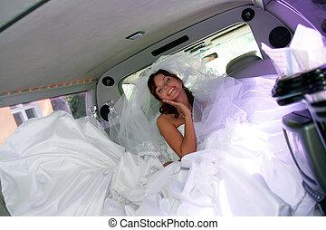 Happy bride in wedding car limo
