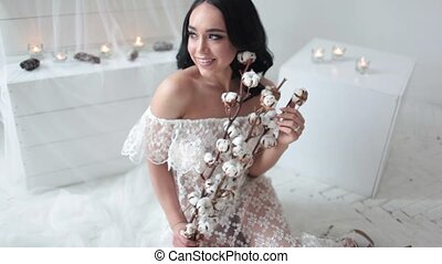 Happy bride is smiling at the background of candles
