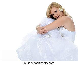 Happy bride lying on the floor.