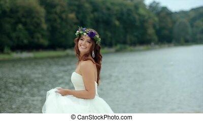 Happy Bride Turns Smiling to Camera - Happy bride in wedding...