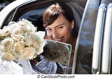Happy Bride With Flower Bouquet - Happy bride sitting in...