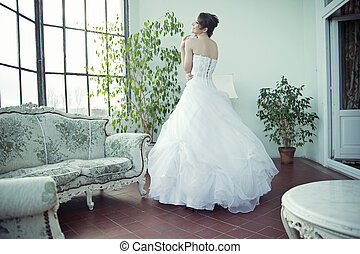 Happy bride with perfect complexion waiting for husband