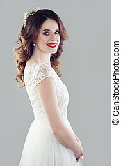 Happy bride woman in white wedding dress. Woman smiling