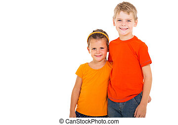 happy brother and sister studio portrait on white