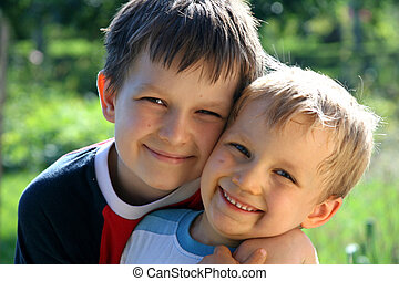 happy brothers - boys in garden