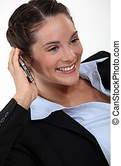 Happy brunette businesswoman on the phone