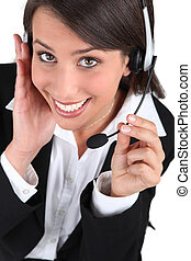 Happy brunette call-centre worker