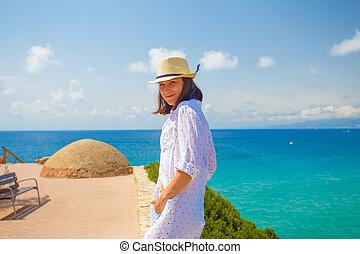 Happy brunette girl on summer resort