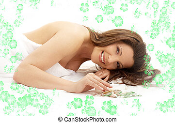 happy brunette in spa with flowers