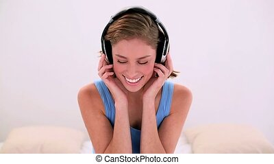 Happy brunette listening to music