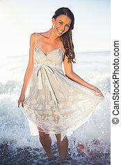 Happy brunette posing in the sea