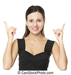 Happy brunette woman pointing up with her fingers