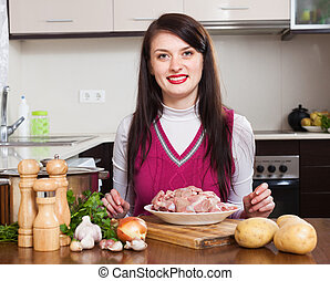 woman  with meat in home kitchen