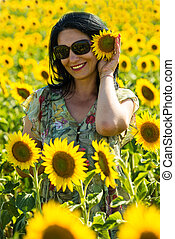Happy brunette woman with sunflower