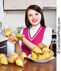 girl with pears in home kitchen