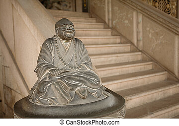 One of a pair of staircase statues, this one happy, the other sad