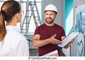 Happy builder showing the contract to his client