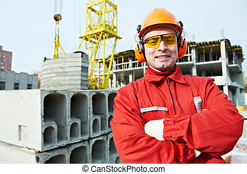 happy builder worker at construction site