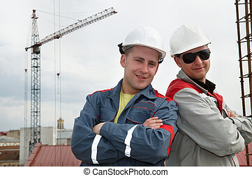 happy builders at construction site