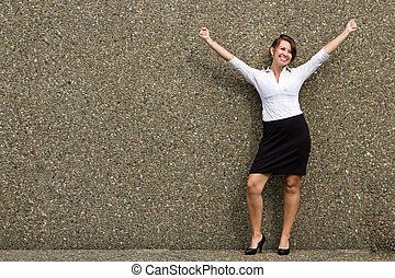 Happy buisness woman with arms up in celebration