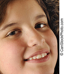 Happy, Bundled Tween - Closeup of a happy, lovely preteen...
