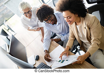 Happy business colleagues in modern office working together