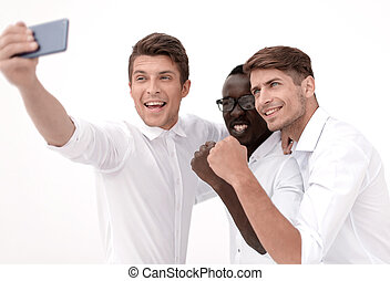 happy business colleagues taking selfies