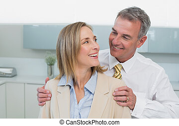 Happy business couple in kitchen