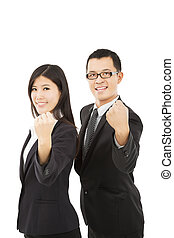 happy business couple with success gesture