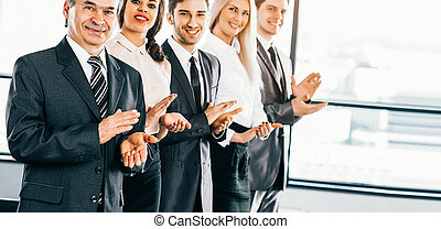 Happy business group applauding the company's success