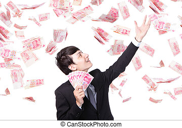 happy business man hold China money ( Renminbi ) under a ...