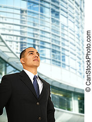 Happy Business Man Outside Building - man over look to the...