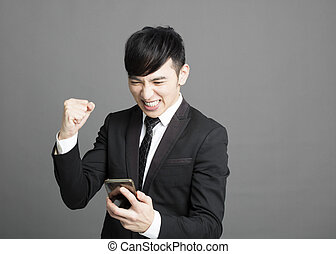 happy business man reading message with phone