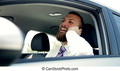 Happy business man sitting in car