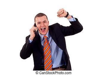 man with cellular phone winning