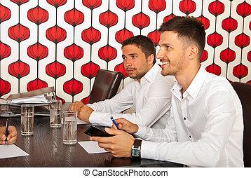 Happy business men at meeting