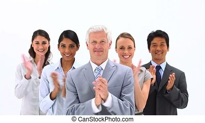 Happy business people applauding against a white background
