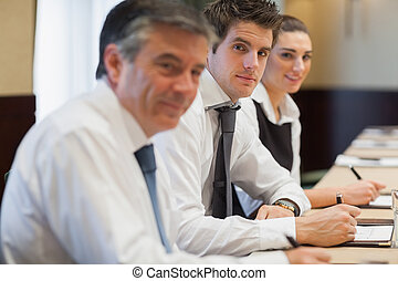 Happy business people at a meeting