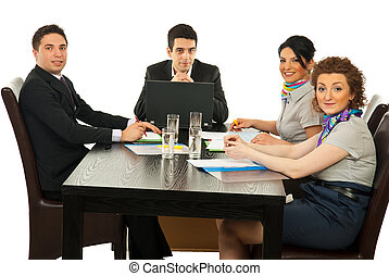 Happy business people at meeting