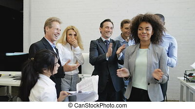 Happy Business People Group Clapping Hands Congradulating Female Colleague With Good Results, Cheerful Team Celebrating Success