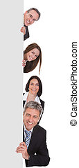 Happy Business People Holding Placard Over White Background